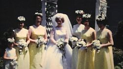 A beautiful bride and her bridesmaids pose for pictures after her wedding in the summer of 1966.
