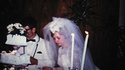 A beautiful bride and groom enjoy all the festivities at their wedding reception in 1966.