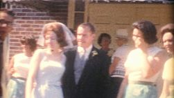 A newlywed couple enjoy posing for pictures with their wedding party, mingling with guests and celebrating their wedding in the summer of 1958.