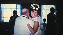 A beautiful bridesmaid has fun dancing with her grandfather at her sister's wedding in 1966.