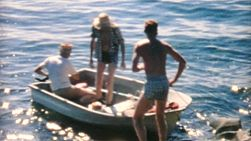 A man prepares to bring in the boat after an awesome fishing trip at sea in the summer of 1967.