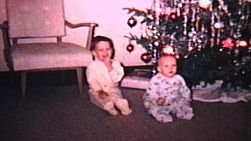 Brothers playing at Christmas. Older brother getting scolded for touching the Christmas ornaments! (1965 - Vintage 8mm film footage)