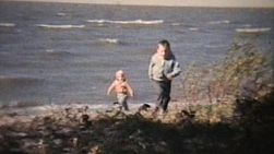 A cute clip of two brothers playing and exploring at the beach on a windy summer day in 1966. (Vintage 8mm footage).