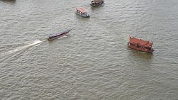 Boats on the Chaophraya River in Bangkok, Thailand.