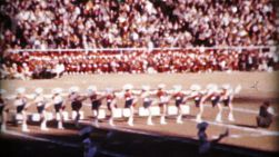 A team of cheerleaders entertain the crowd at the college football game on New Year's Day in 1962.
