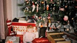A shot of gifts and presents waiting underneath the Christmas tree on Christmas morning in Cleveland, Ohio in 1954.