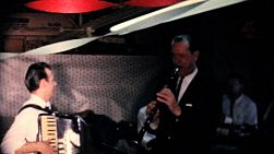A clarinet player enjoys playing with the band at the company Christmas party in December 1963.