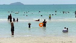 People enjoy spending time at the beach on a gorgeous summer's day in Sattahip, Thailand on the Gulf of Thailand.