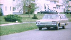 A mom drives her classic vintage 1967 Dodge Station wagon home from a shopping trip.