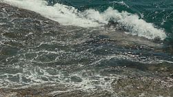 Close up of waves crashing on rocks in Western Australia.