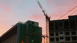 Colourful sunset behind a high rise construction site in Pattaya, Thailand.