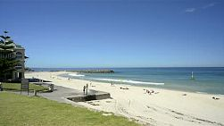 Cottesloe beach in Perth, Western Australia, on a quiet day in summer, with people enjoying the popular beach to escape the heat.