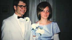 A cute couple get ready to leave for the prom but not before the dad helps with the camera in 1966.