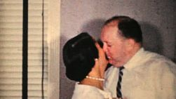 A couple share an awkward kiss as they celebrate bringing in the New Years in 1964.