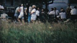 Couples enjoy dancing and having fun at a large family picnic in the summer of 1962.