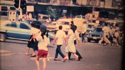 Tourists try to navigate the crazy unsafe traffic of downtown Bangkok, Thailand in 1970.