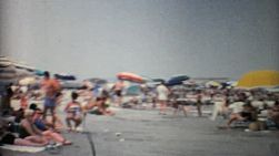 Crowds of people enjoy a beautiful sandy beach in Florida in the summer of 1967.
