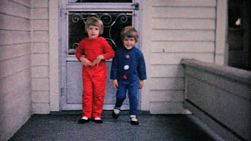 Two cute sisters show off their brand new home made fall outfits on the front porch in 1961.