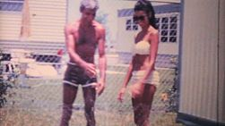 A father and daughter enjoy cooling off and playing in a sprinkler while on holidays in tropical Florida in the summer of 1969.