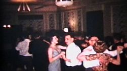 People enjoying themselves dancing and having fun at a wedding reception.