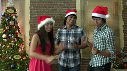 Three Asian friends have fun and share a festive moment by dancing in front of the Christmas tree during the holidays.