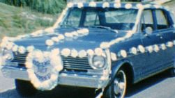 A decorated wedding getaway car sits ready for action in the summer of 1967.