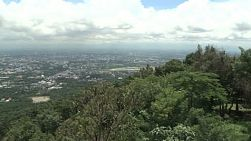 A right to left pan of the look out from Doi Suthep mountain in Chiang Mai, Thailand.