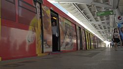 BANGKOK, THAILAND - OCTOBER 9 2013: Doors closing as train departs from a skytrain station in Bangkok, Thailand.