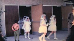 A group of girls and boys leave the church after receiving their first communion in the fall of 1962.