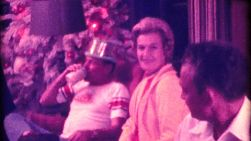 A beautiful family enjoys spending time celebrating a special birthday during Christmas of December 1974.