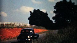 Old cars driving through the lovely Virginia countryside on a family vacation in 1940.