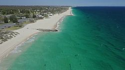 Aerial view of the clear water and sandy beach at City Beach in Perth, Western Australia.