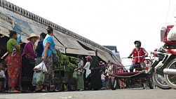 A classic shot of a busy Asian border town market in Mae Sot, Thailand.