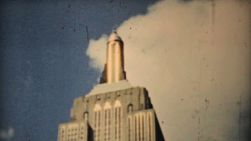 Visiting downtown New York City and looking up at the Empire State Building in 1940.