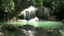 A slow motion shot of beautiful Erawan Waterfalls in the western province of Kanchanaburi, Thailand.