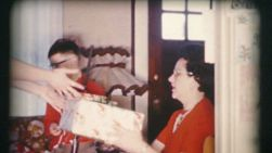 An excited mother finally gets the new mixer she's dreamed about on Christmas Day in 1958!