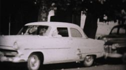 Families getting out of various classic old family cars in the summer of 1957.