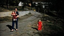 A family enjoys spending time together and going for a walk on a lovely fall day in Akron, Ohio in 1961.