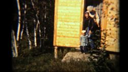 A young family leaves the cabin on their way to run an errand.