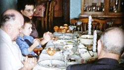 A family prays and gives thanks to God for the turkey dinner while  celebrating Christmas in Cleveland, Ohio in 1956.