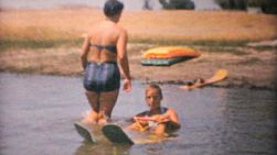 A family enjoys time together water skiing on the lake during the summer of 1961.