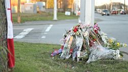 A roadside memorial marks the death of a young police officer killed in the line of duty.