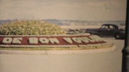 "A pretty French flower roundabout with a ""bon voyage"" message in Quebec, Canada in 1958."