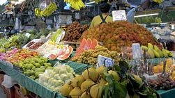 A fresh fruit market in Bangkok, Thailand, with a large variety of fruit for sale.