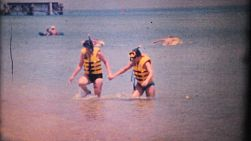 Friends enjoy a fun time snorkelling together in gorgeous Southern Thailand in 1970.