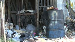 A shot of an old oil drum sitting amongst a pile of garbage in the slums of Bangkok, Thailand.