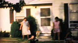 Grandchildren enjoy playing in front of their Grandma's house in the summer of 1967.