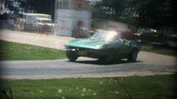 A green vintage Corvette wipes out at a car rally while taking a turn at a car rally in the summer of 1975.