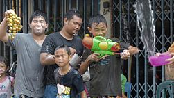 Bangkok, Thailand - April 14, 2014: A group of boys enjoying the water fights that are part of the annual Songkran Festival in Thailand.