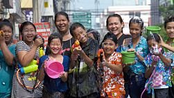 Bangkok, Thailand - April 14, 2014: A group of Thai children and parents posing and shooting their water pistols, as they enjoy a water fight as part of the annual Songkran Festival in Thailand.